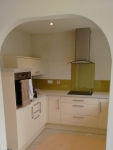 Archway in fitted kitchen